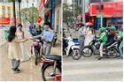 Cô dâu chú rể phát khẩu trang miễn phí trên phố khiến dân mạng tranh cãi gay gắt