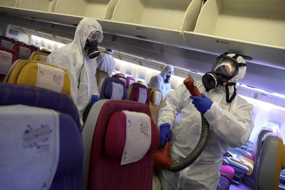 Làm thế nào để phòng tránh virus corona khi đi máy bay?-2