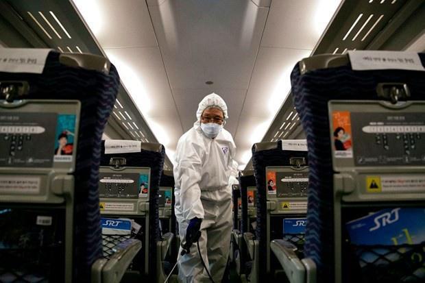 Làm thế nào để phòng tránh virus corona khi đi máy bay?-3