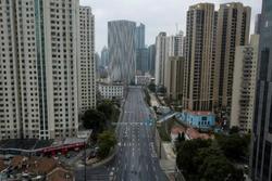 Thành phố sầm uất nhất Trung Quốc 'rơi vào hôn mê' vì virus corona