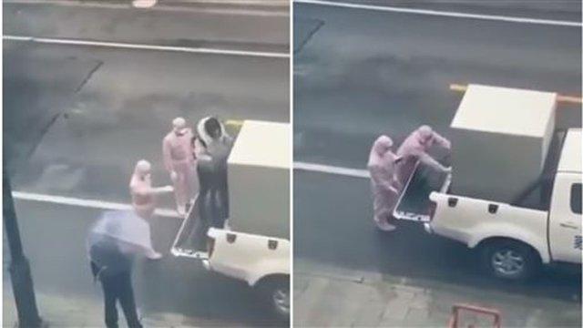Hình ảnh xúc động: Cặp đôi ôm nhau trước lúc người chồng bị cách ly vì nghi nhiễm 2019-nCoV-2