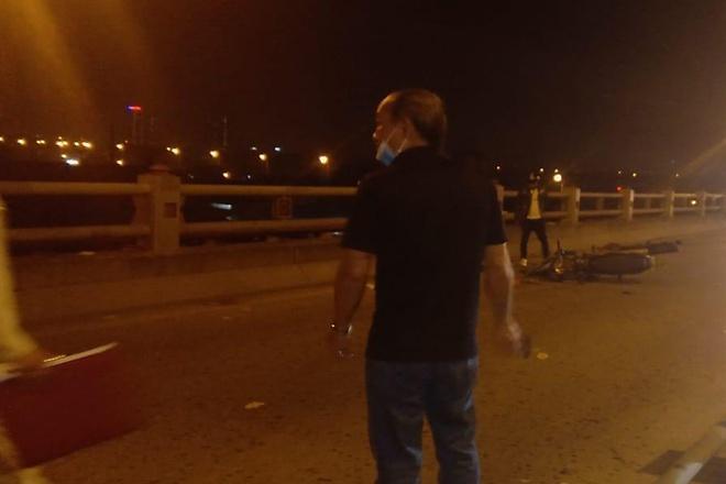 Người phụ nữ dắt con xin tiền ở cầu Thanh Trì bị xe máy tông chết-1