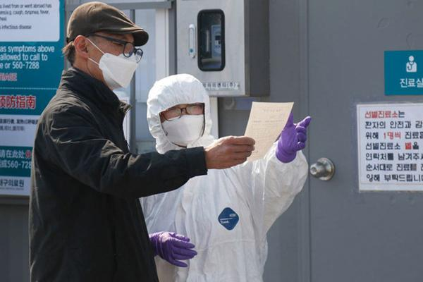 Hàn Quốc: Thêm 52 trường hợp dương tính với virus corona, tổng cộng 82 người đã lây từ bệnh nhân siêu lây nhiễm-1