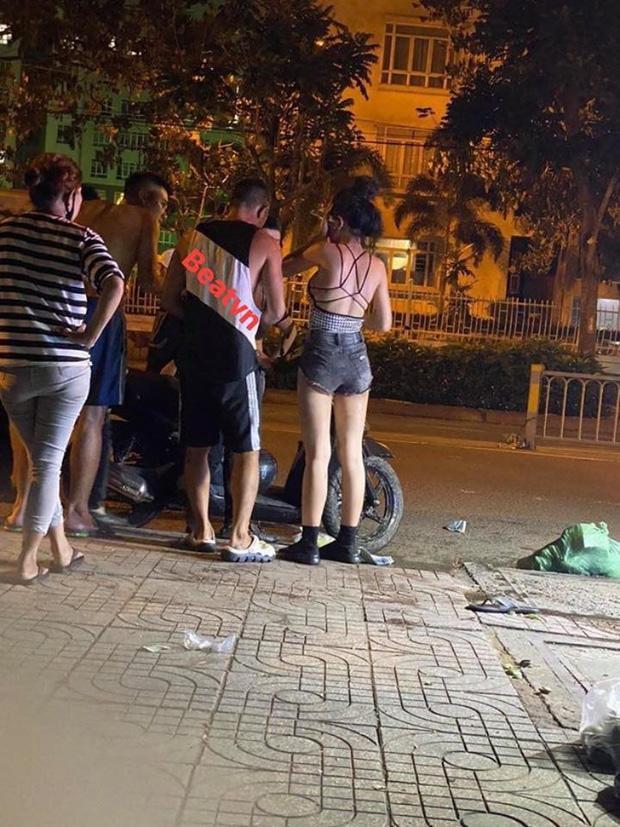 Lương Bằng Quang và Ngân 98 nói gì về bức ảnh bị 10 thanh niên hành hung giữa phố-1