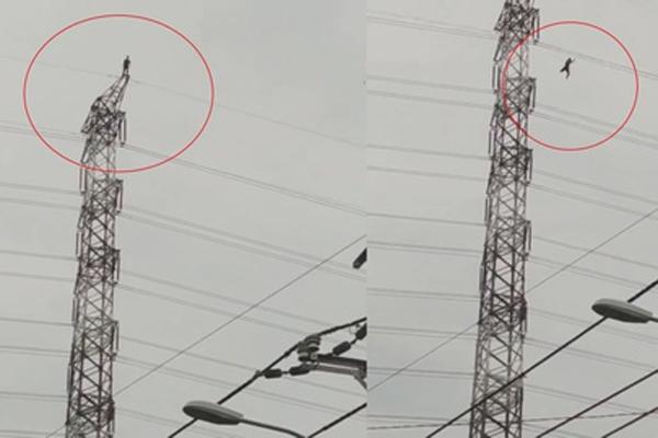Clip: Người đàn ông đứng trên đỉnh cột điện cao thế rồi nhảy xuống ở TP.HCM-1