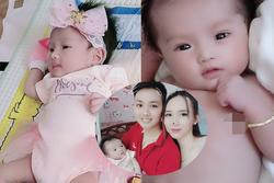 Con gái 1 tháng tuổi của người đàn ông đầu tiên sinh con ở Việt Nam càng lớn càng yêu