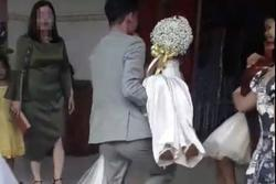 Sự thật clip cô dâu lỡ có bầu được chú rể bế vào nhà dù bị mẹ chồng bắt đi cửa sau