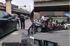 Người đàn ông đi xế hộp dừng giữa phố Hà Nội tiểu bậy như đang ở toilet nhà mình