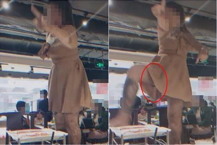 Đang ngồi ăn, cô gái bất ngờ đứng lên ghế nhảy nhót hở cả nội y