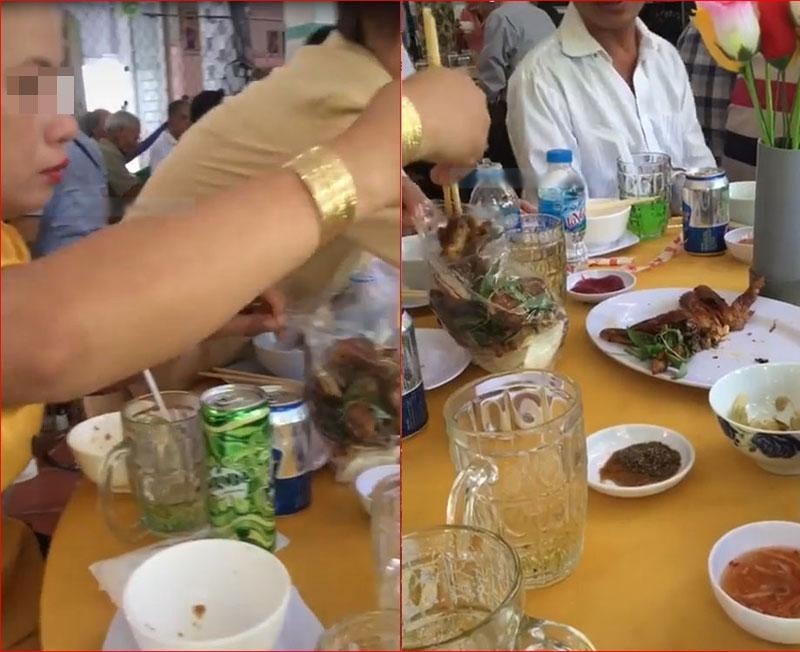 Hai phụ nữ đi ăn tiệc đã đời xong rủ nhau tay xách nách mang cỗ thừa đem về-1
