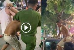Tài xế say rượu cởi trần, gây tai nạn còn nhảy lên nắp capo chống đối CSGT