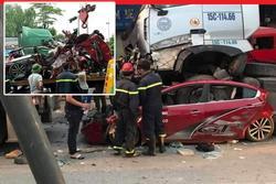Dừng đèn đỏ ở Hà Nội, ô tô con bị container chồm lên nóc, 3 người tử vong