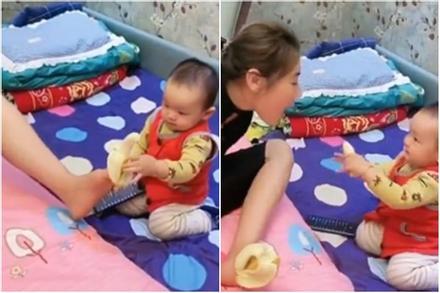 Bà mẹ cụt tay cho con ăn bằng chân, phản ứng của đứa trẻ làm nhiều người ngạc nhiên