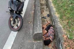 Thanh niên say rượu nằm co quắp dọc đường, phát ra âm thanh lạ ai nấy hết hồn