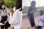 Clip: Nữ sinh bị đánh hội đồng ngay bên đường, quỳ gối xin lỗi vẫn bị túm tóc tát tới tấp