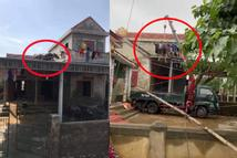 Clip: Lũ rút, 2 con trâu vẫn đứng yên trên mái nhà và màn giải cứu thót tim
