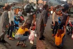 Clip: Thanh niên vũ phu lôi bạn gái ra đánh đập tàn nhẫn giữa đường, thẳng tay tát luôn người can ngăn