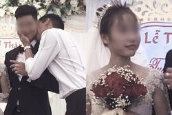 Cô dâu tái mặt nhìn chú rể bị một người đàn ông cưỡng hôn trên sân khấu