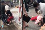 Đang vui chơi trong quán bar trên phố Tạ Hiện, cô gái bị bạn gái quản lý đánh đập, ném gạt tàn vào mặt-3