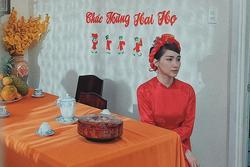 Xôn xao hình ảnh Hòa Minzy mặc áo dài đỏ chuẩn bị làm lễ gia tiên