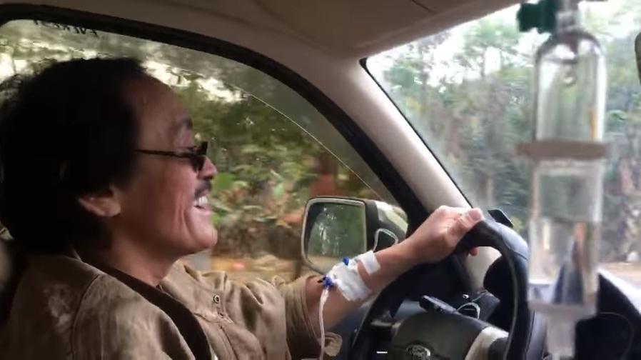 Nghệ sĩ Giang Còi gây hoang mang với clip vừa truyền nước vừa lái xe-3