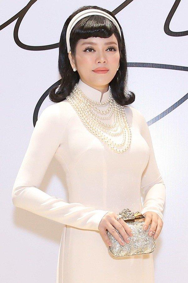 Muôn kiểu phụ kiện mix cùng áo dài Tết được sao Việt lăng xê nhiệt tình-13