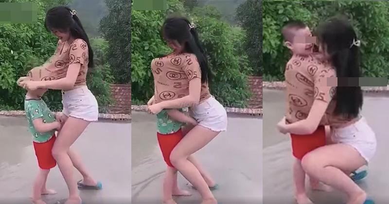 Cô gái gây tranh cãi kéo áo thun trùm lên đầu bé trai rồi ôm sát ngực-1