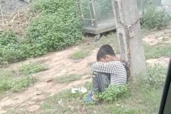 Lạng Sơn: Cha xích cổ con vào cột điện ven đường vì... con lười học?
