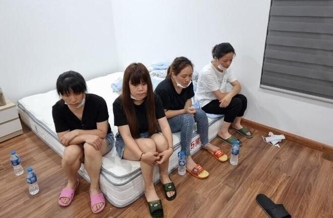Bắt quả tang 12 người Trung Quốc nhập cảnh chui trong chung cư ở Hà Nội-1