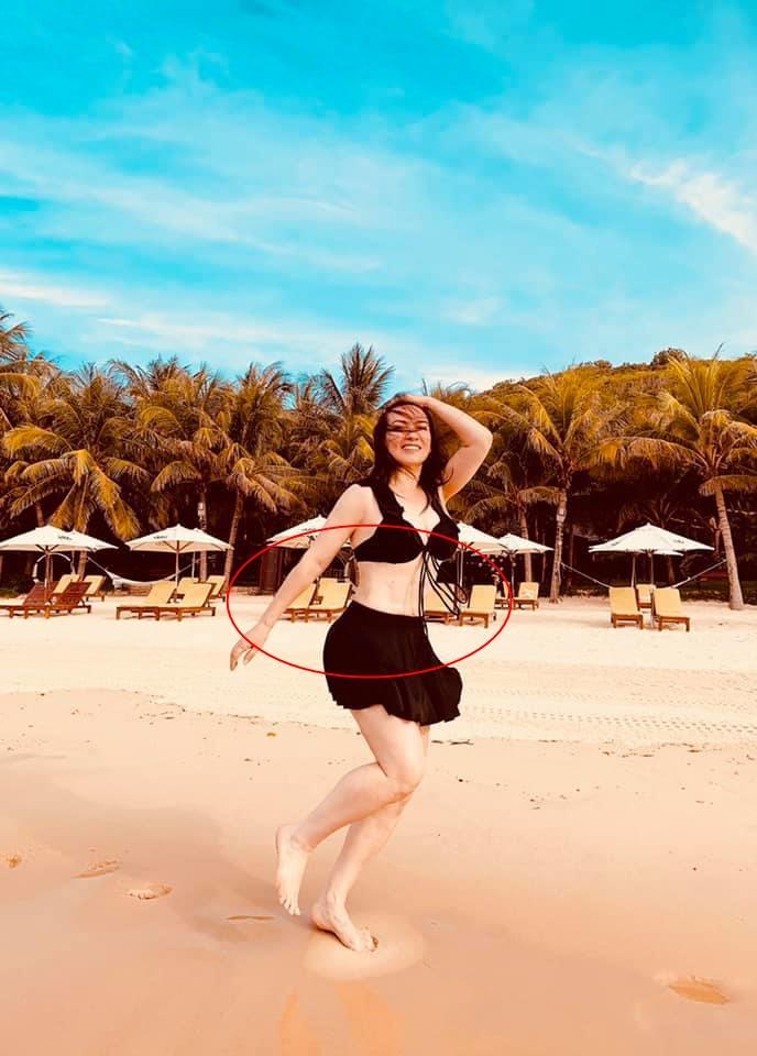 Phi Nhung hiếm hoi tung hình bikini bên trai đẹp nhưng vòng eo cứ sai sai-3