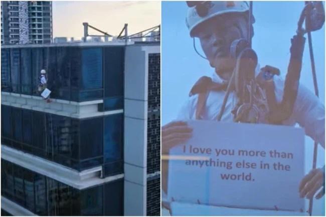 Nhìn ra cửa kính tòa nhà từ tầng 17, cô gái ngạc nhiên khi thấy bạn trai treo lơ lửng-1