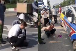 Kỷ luật chiến sĩ công an thờ ơ đứng nhìn tài xế taxi bị thương vật lộn với tên cướp