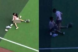 Cặp học sinh ngang nhiên diễn 'cảnh nóng' trên sân tập thể dục