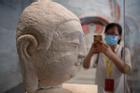 Đầu tượng Phật trở lại Trung Quốc sau một thế kỷ bị đánh cắp