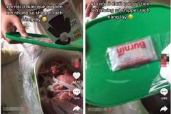 Khui hộp đồ ăn bà nội gửi dưới quê lên, cô gái thấy cả bọc tiền được giấu kín