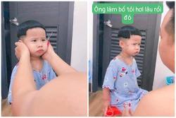 Cười ngất biểu cảm 'cực căng' của cậu nhóc khi bố đè ra cắt tóc