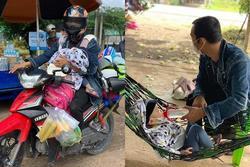 Ông bố địu con nhỏ trước bụng chạy xe máy từ Đồng Nai về Hà Tĩnh