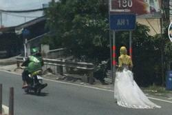 'Bí ẩn' cô gái mặc váy cưới đi bộ giữa đường xôn xao MXH