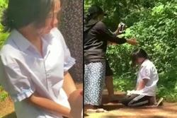 Clip: Nữ sinh lớp 7 quỳ gối giữa đồi thông, bị tát chảy máu mũi